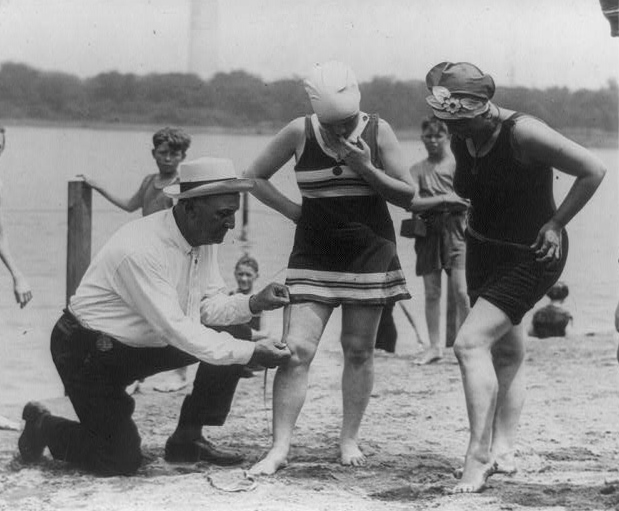 Policeman Measuring Bathing Suit