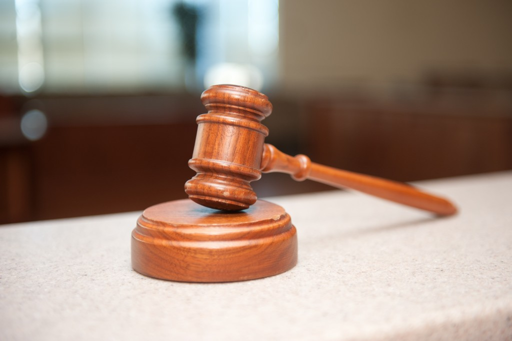 gavel in court over online review suing